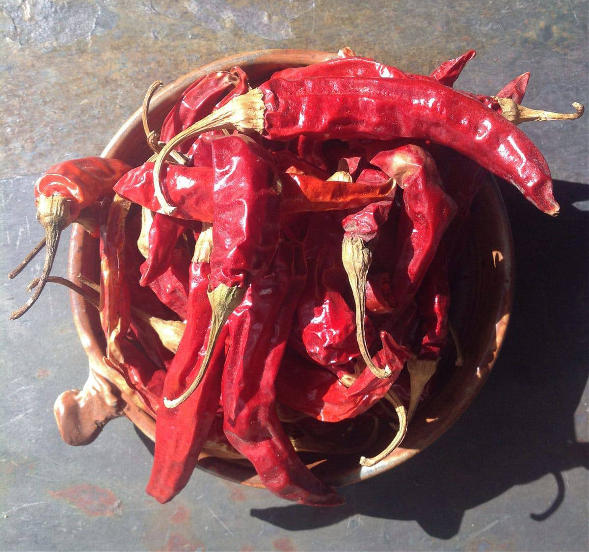 dried red ristra peppers in a bowl