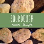 Homemade sourdough naan on a baking sheet.