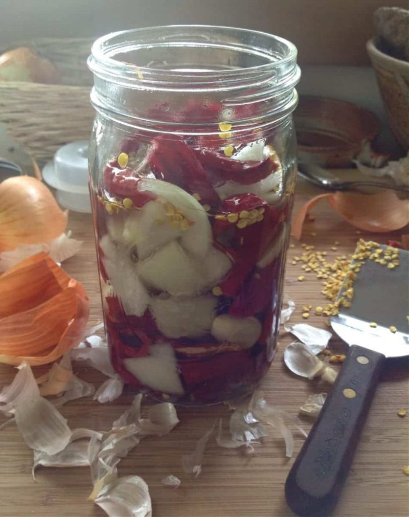 peppers and onions in a jar to ferment