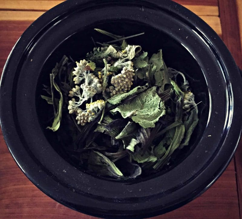 dried herbs in a mini slow cooker