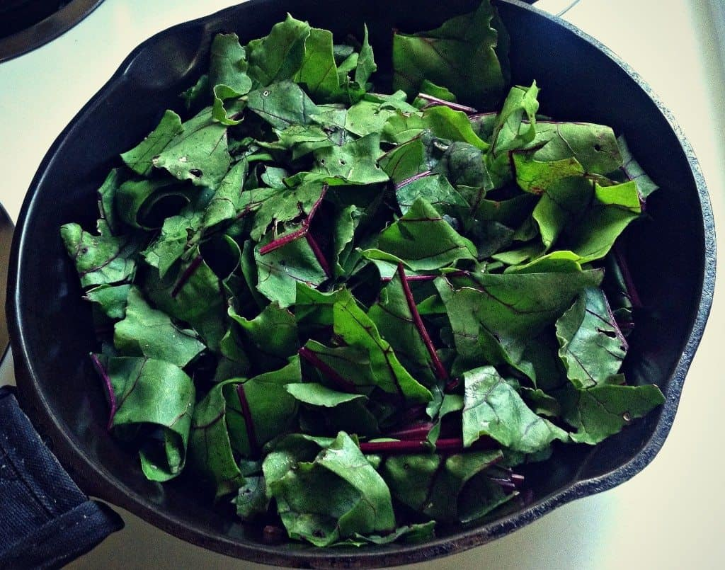 beet greens in pan