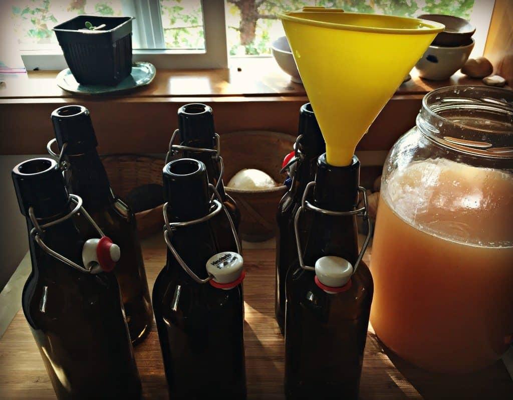 funnel soda into bottles