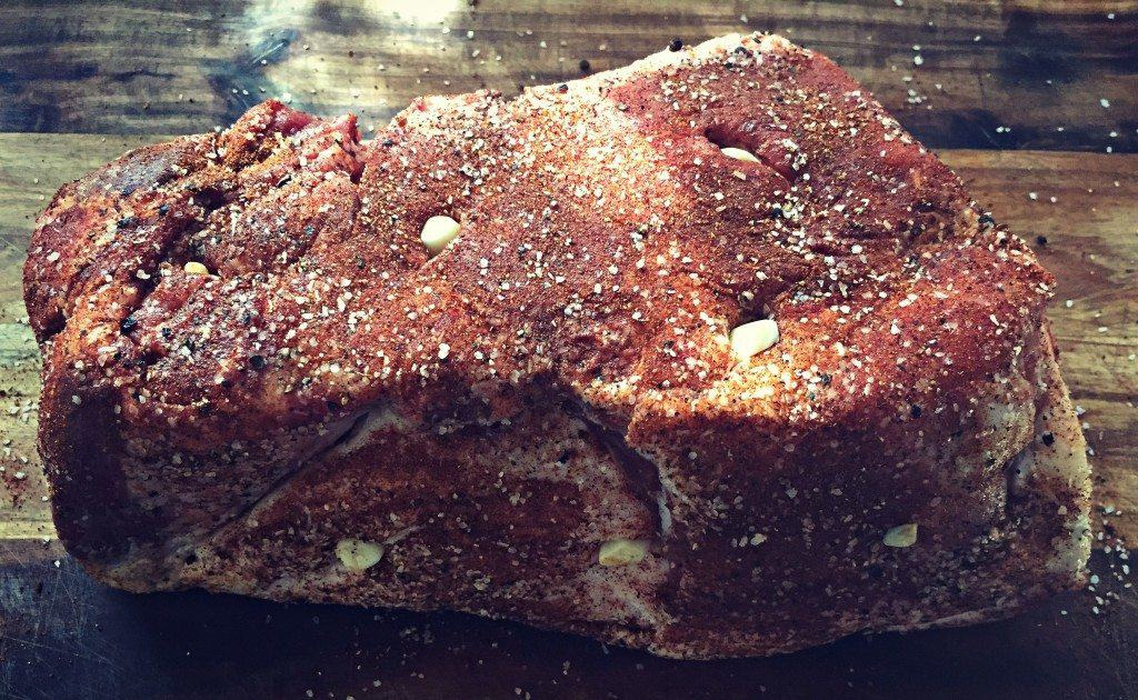 pork shoulder stuffed with garlic