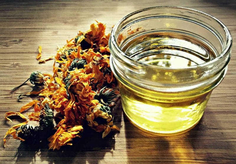 calendula oil with dried calendula flowers