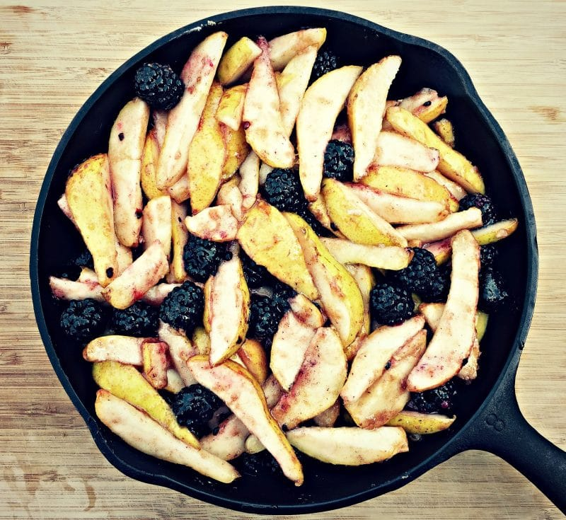 skillet with pears and blackberries