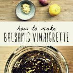 The ingredients for homemade balsamic vinaigrette on a cutting board, and a jar of homemade balsamic vinaigrette.