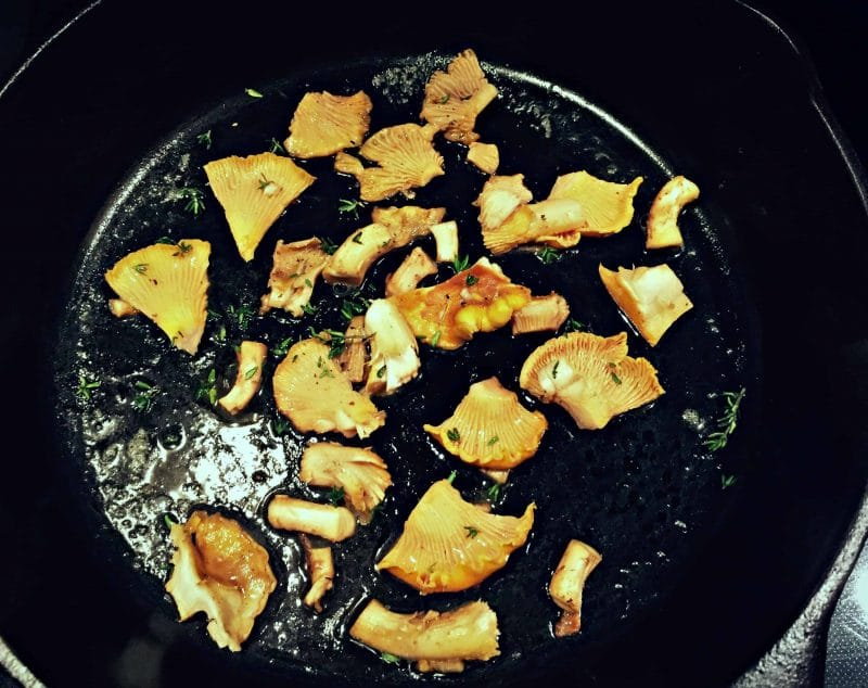 cooking chanterelles in butter and fresh thyme
