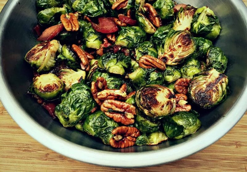 brussels sprouts with bacon and maple pecans in a metal bowl