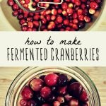 Mashing fresh cranberries in a large bowl and a jar filled with fermented cranberries.