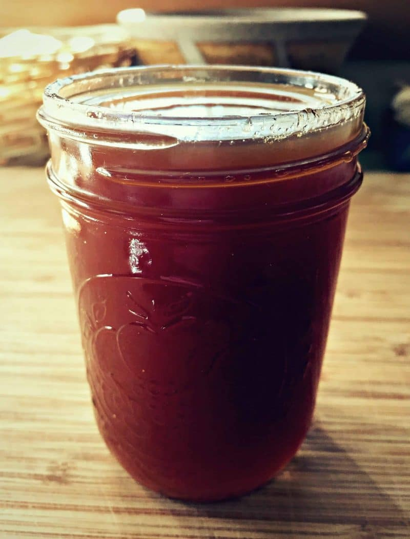 rose hip syrup in a mason jar