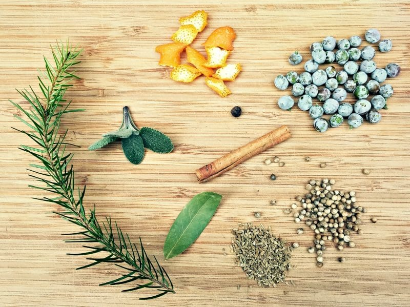 winter infused gin botanical ingredients on a cutting board