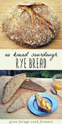 No knead sourdough rye bread on a cutting board, and slices of sourdough rye with jam.