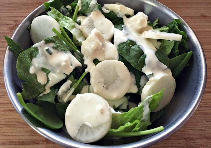blue cheese dressing on a salad