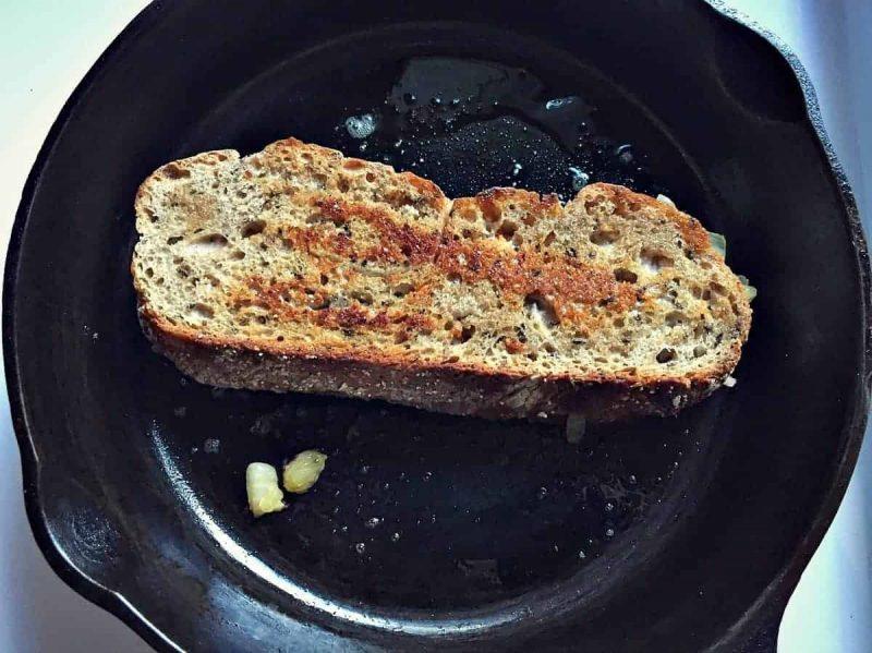flip reuben sandwich in cast iron skillet