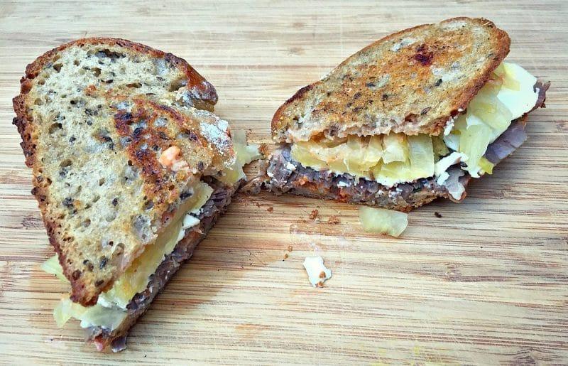 homemade reuben sandwich on a cutting board
