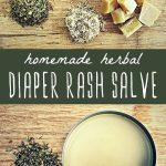 A tin of herbal diaper rash salve with fresh herbs.