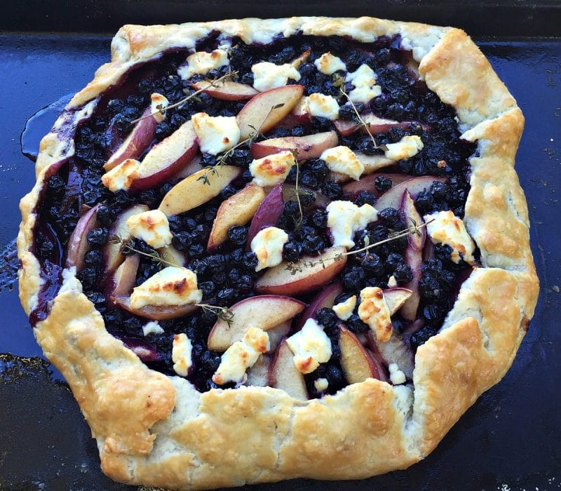 baked peach and blueberry galette with goat cheese and thyme