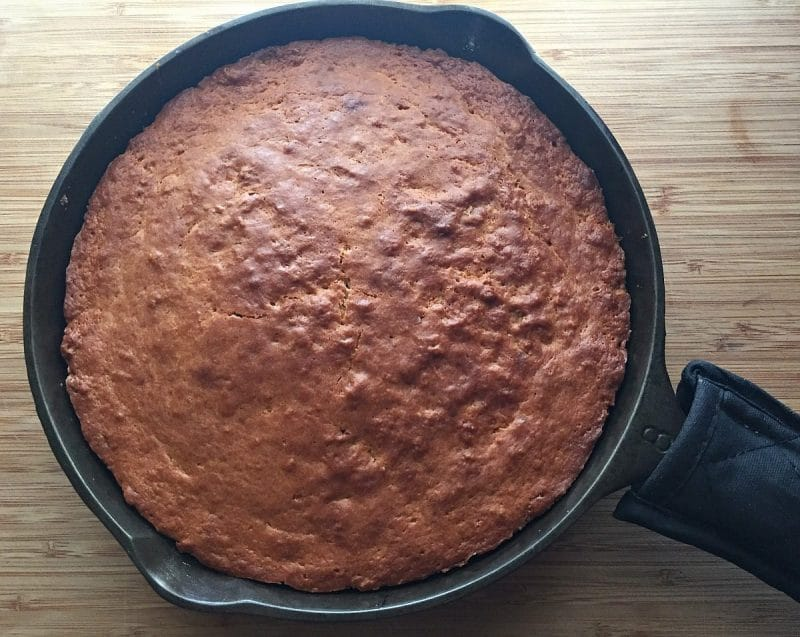 baked plum caked in cast iron skillet
