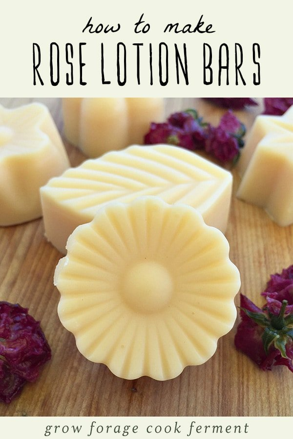 Homemade rose lotion bars on a wood background.