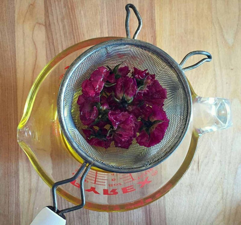 straining rose infused oil