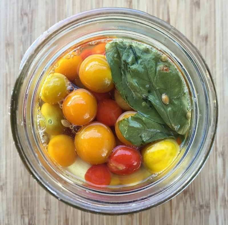 fermented cherry tomatoes in a jar top view