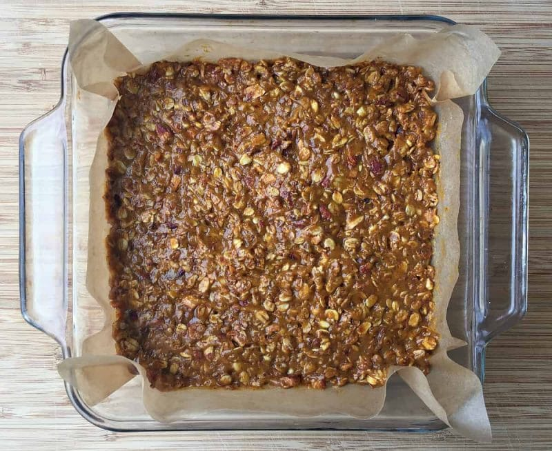 pumpkin granola bars pressed into a pan