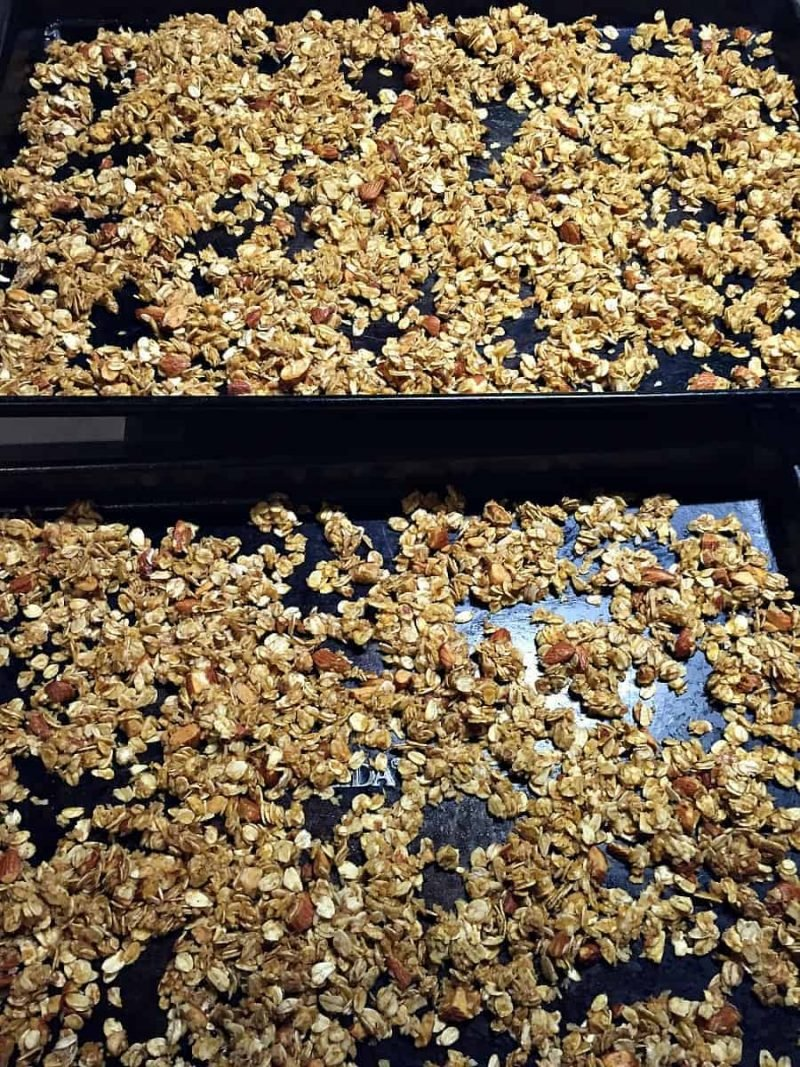 two sheet pans with baked pumpkin granola