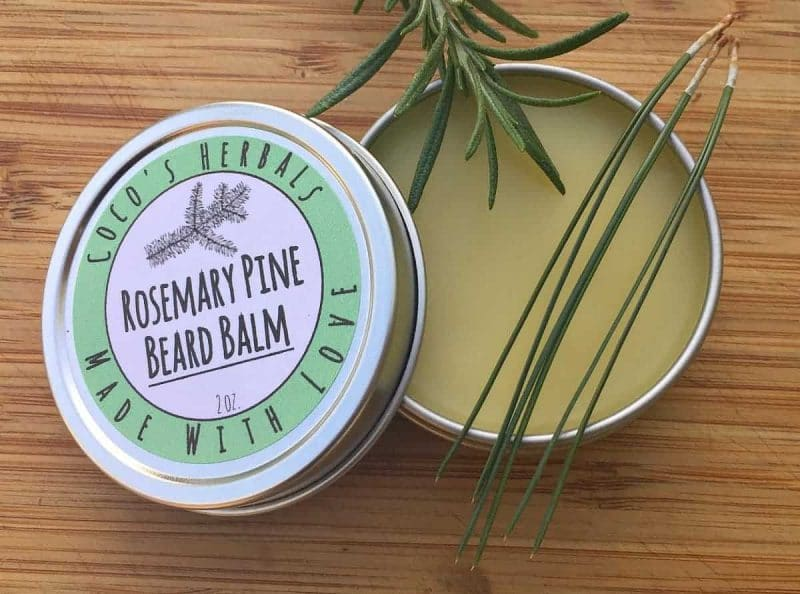 rosemary pine beard balm in a tin with a label