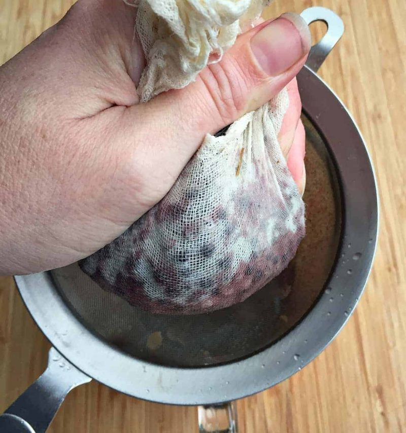 squeezing-out-elderberry-tincture