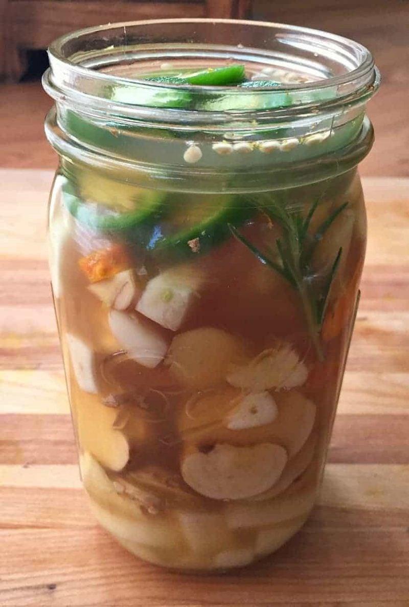 making fire cider in a quart jar