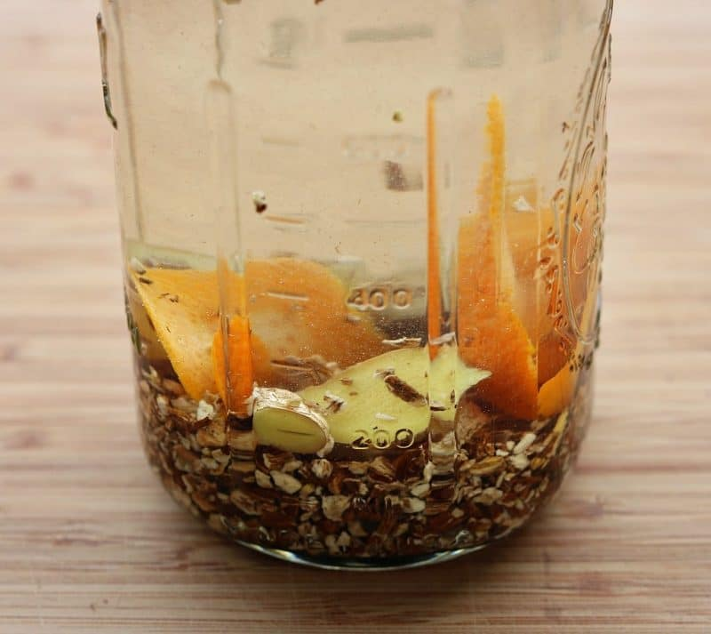 Dandelion roots being infused in vodka