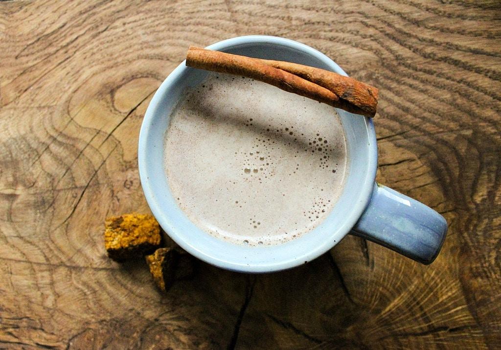 a mug of chaga chai with a cinnamon stick