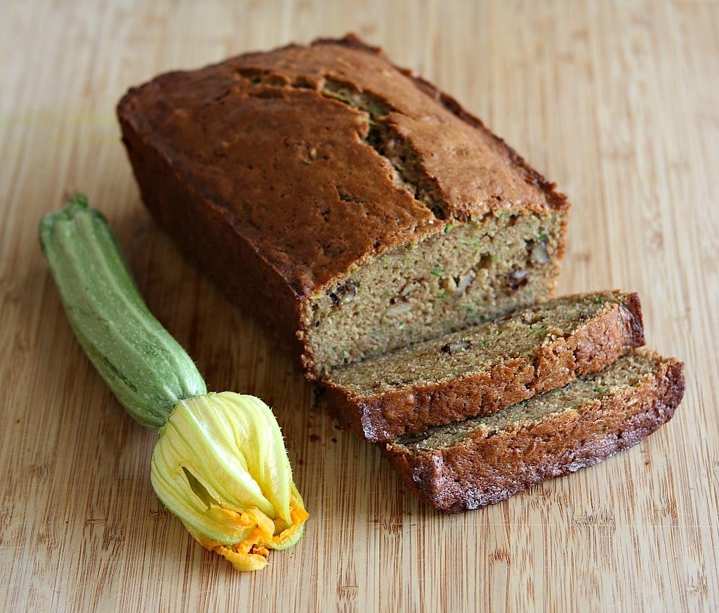 a loaf of sliced zucchini spice bread
