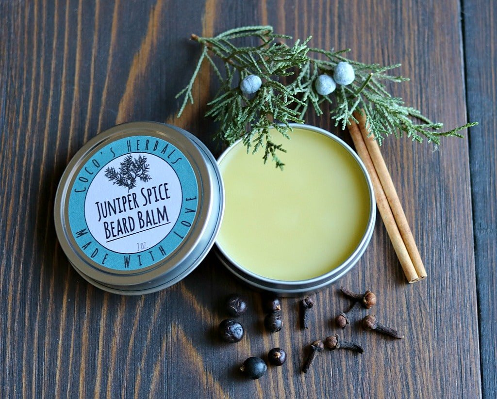 juniper spice bearm balm in a tin with a label