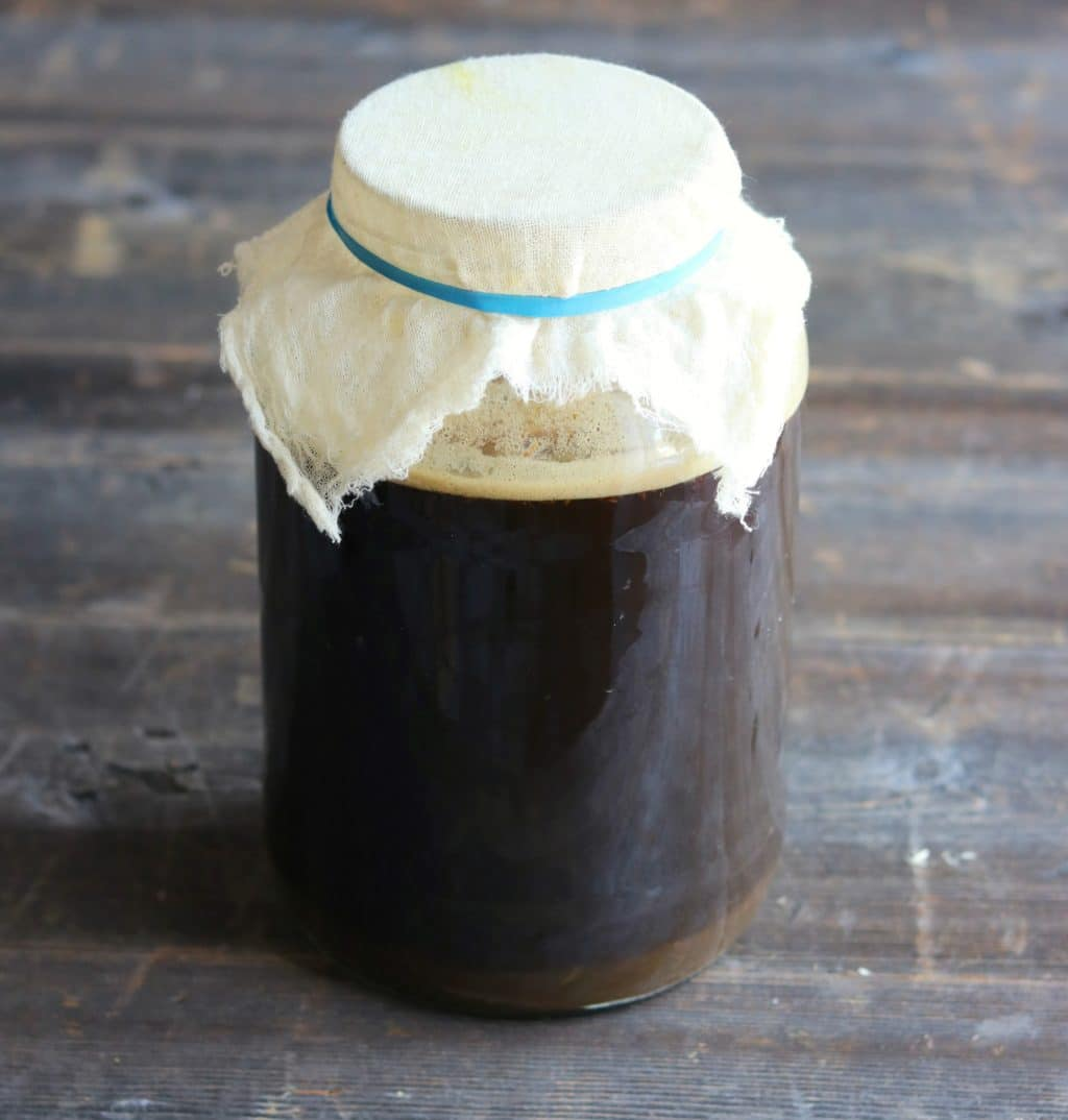 fermenting the root beer in a one gallon wide mouth jar with cheesecloth