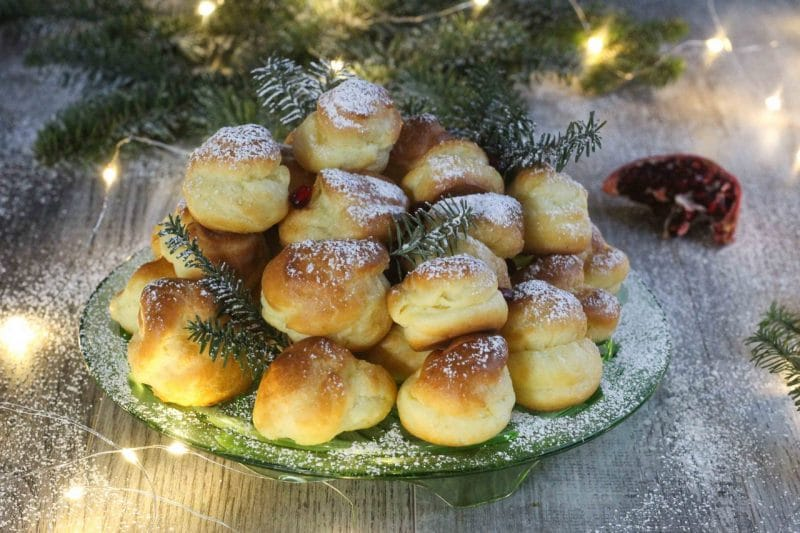 conifer profiteroles stacked up on a plate