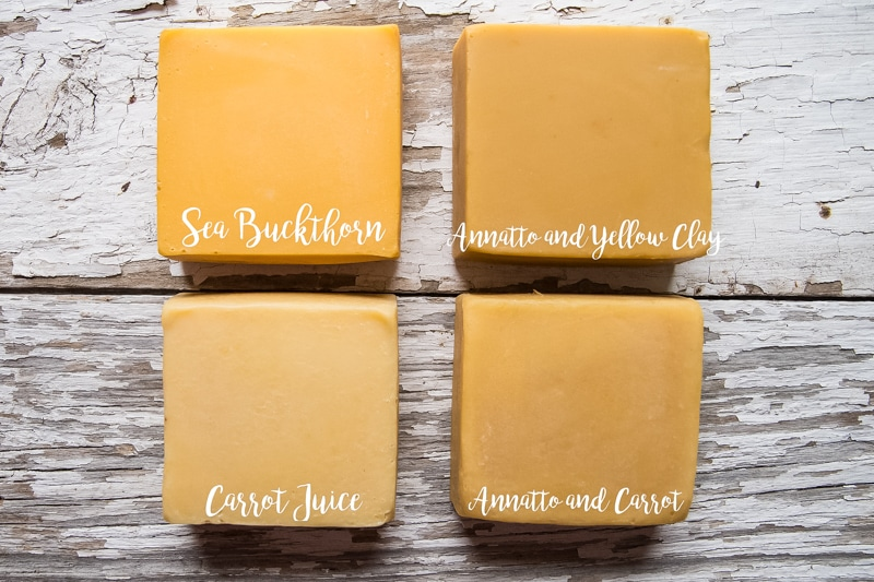 Four bars of dandelion soap showing the difference in natual yellow colorants