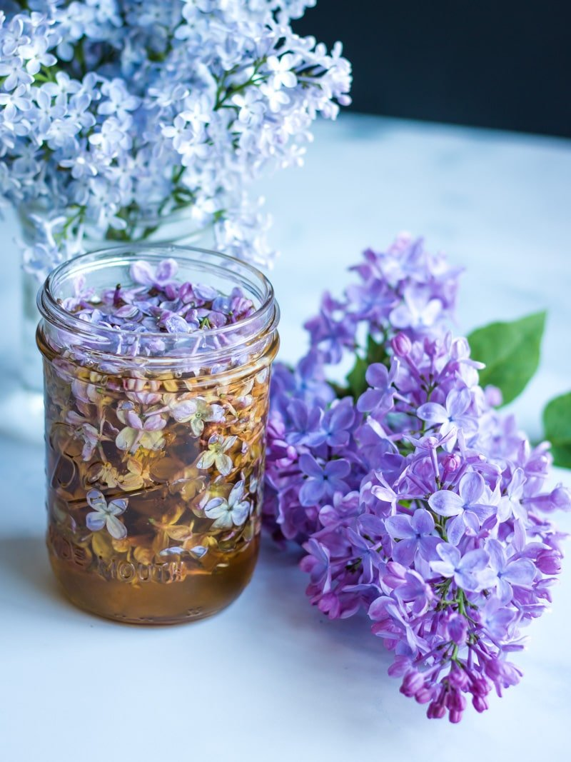 lilac flower infused honey in a jar