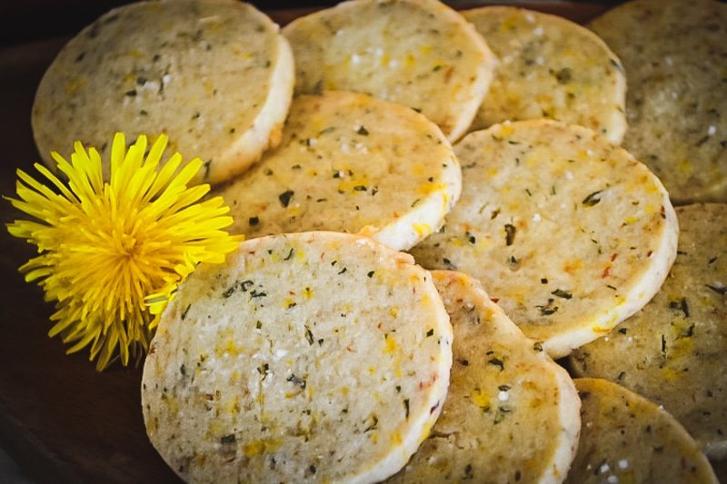 dandelion and rosemary shortbread cookies with a dandelion flower