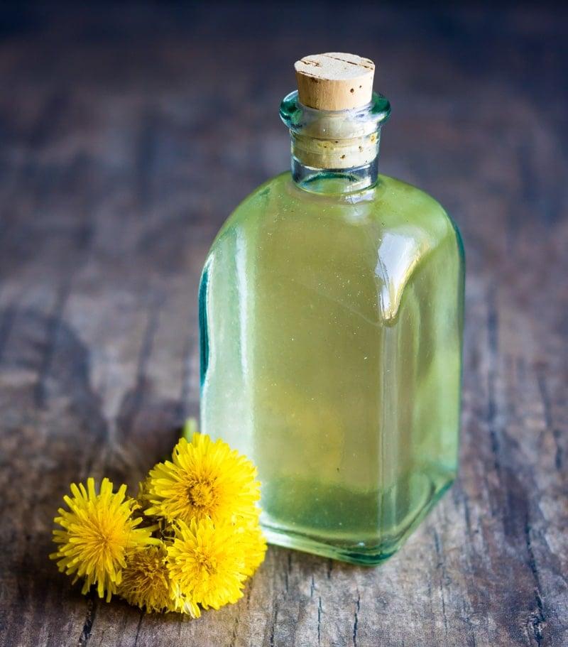 the finished strained dandelion vinegar