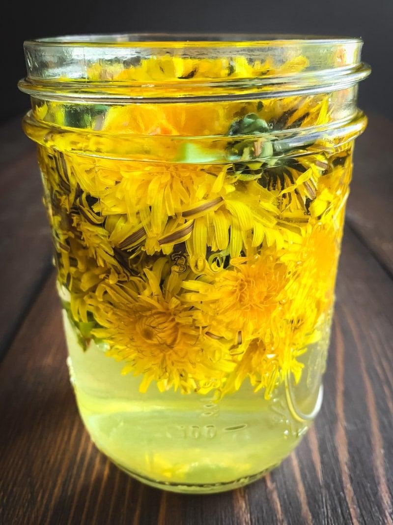 a jar of dandelion infused vinegar