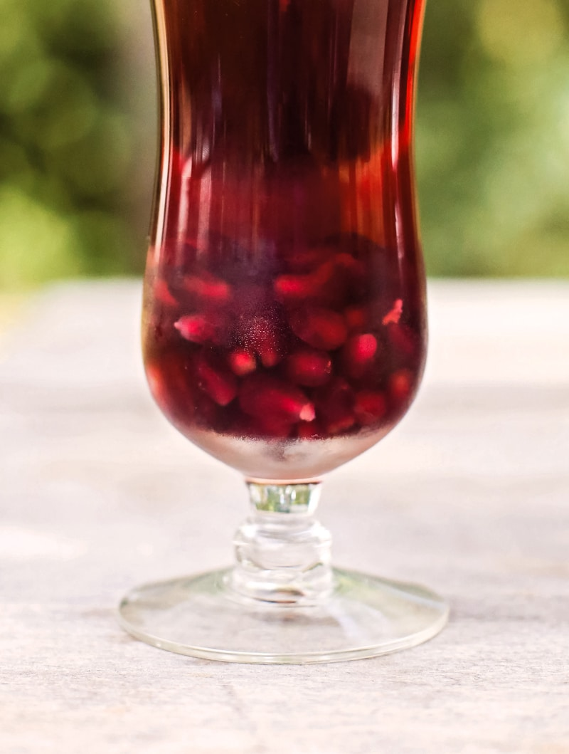 glass of pomegranate wine