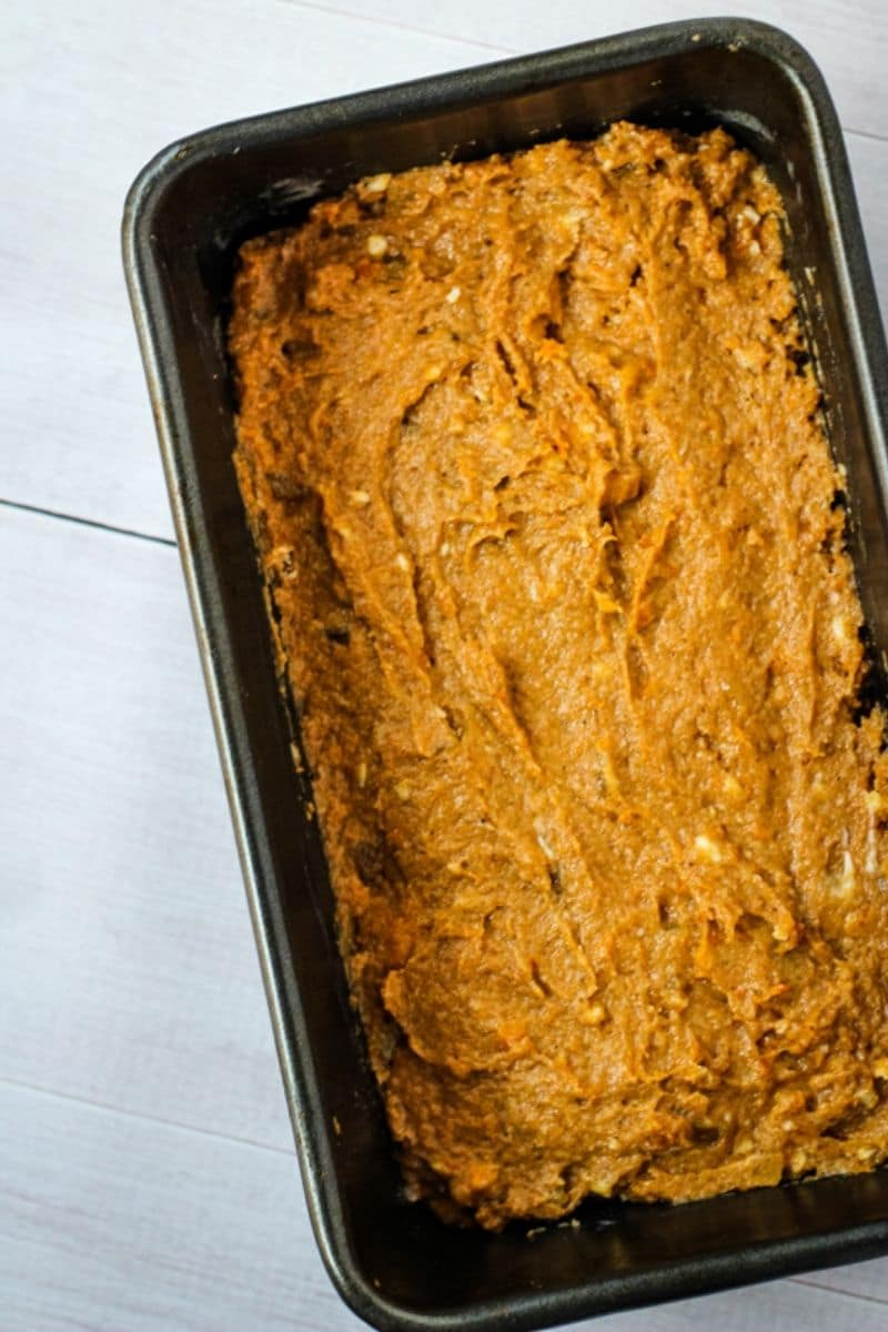 spreading persimmon bread into loaf pan