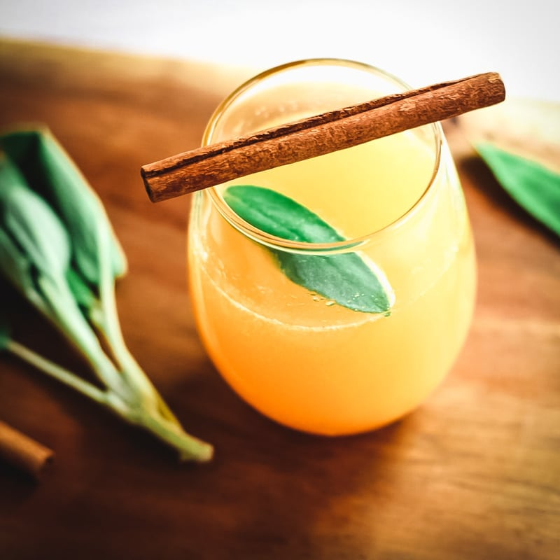 persimmon cocktail with sage and cinnamon