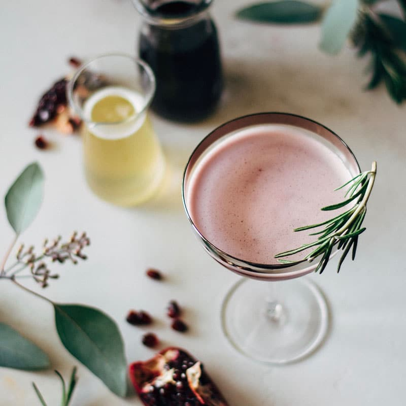 pomegranate martini with rosemary honey syrup