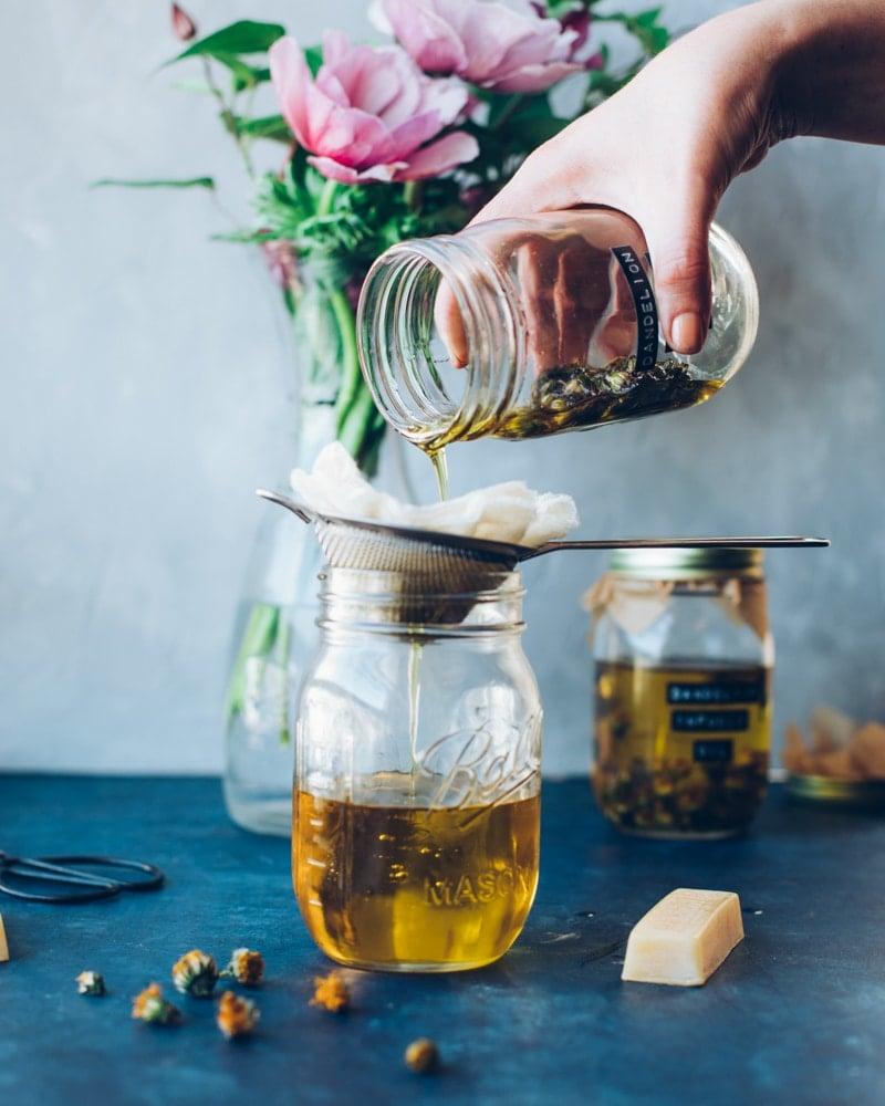 straining dandelion infused oil
