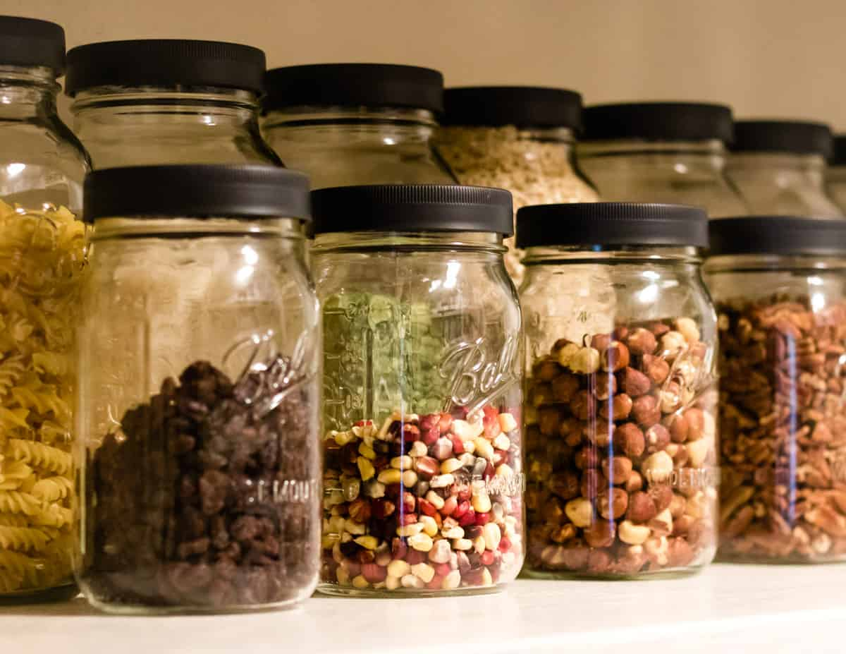 ball jars lined up in a pantry