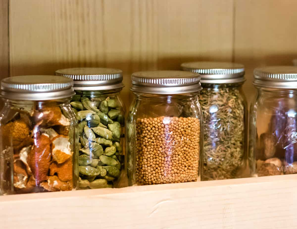 ball mini jars in a spice rack