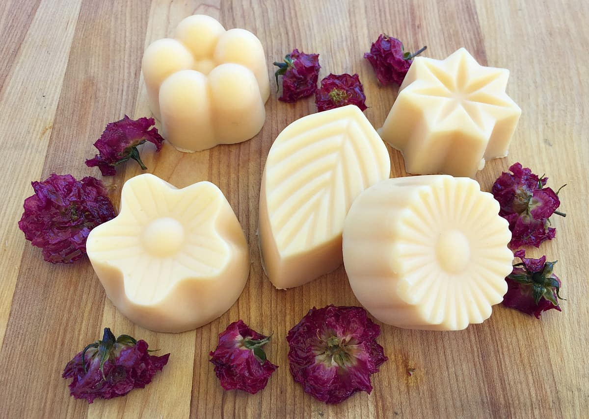 rose lotion bars on a wooden board