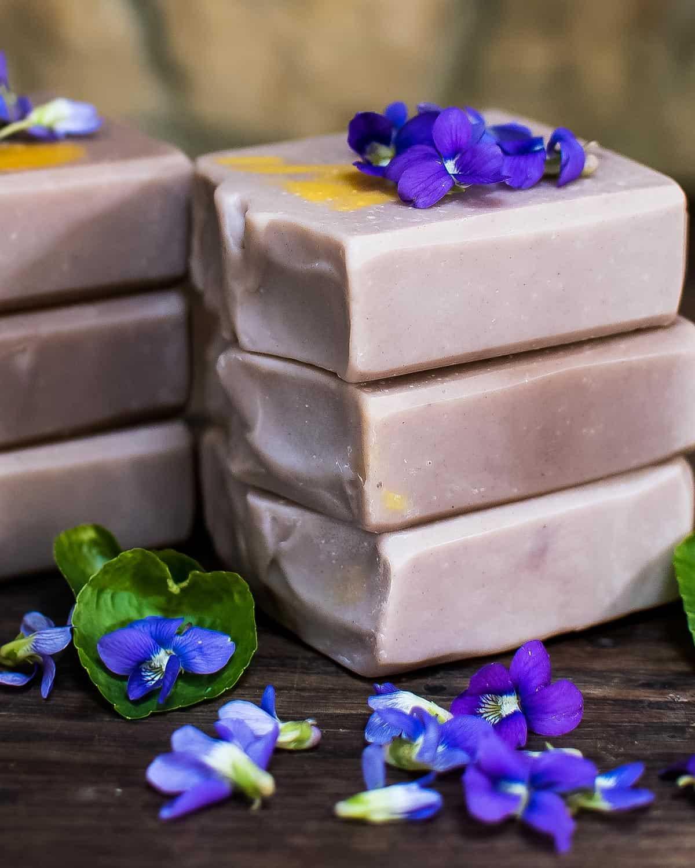 a stack of wild violet soap bars